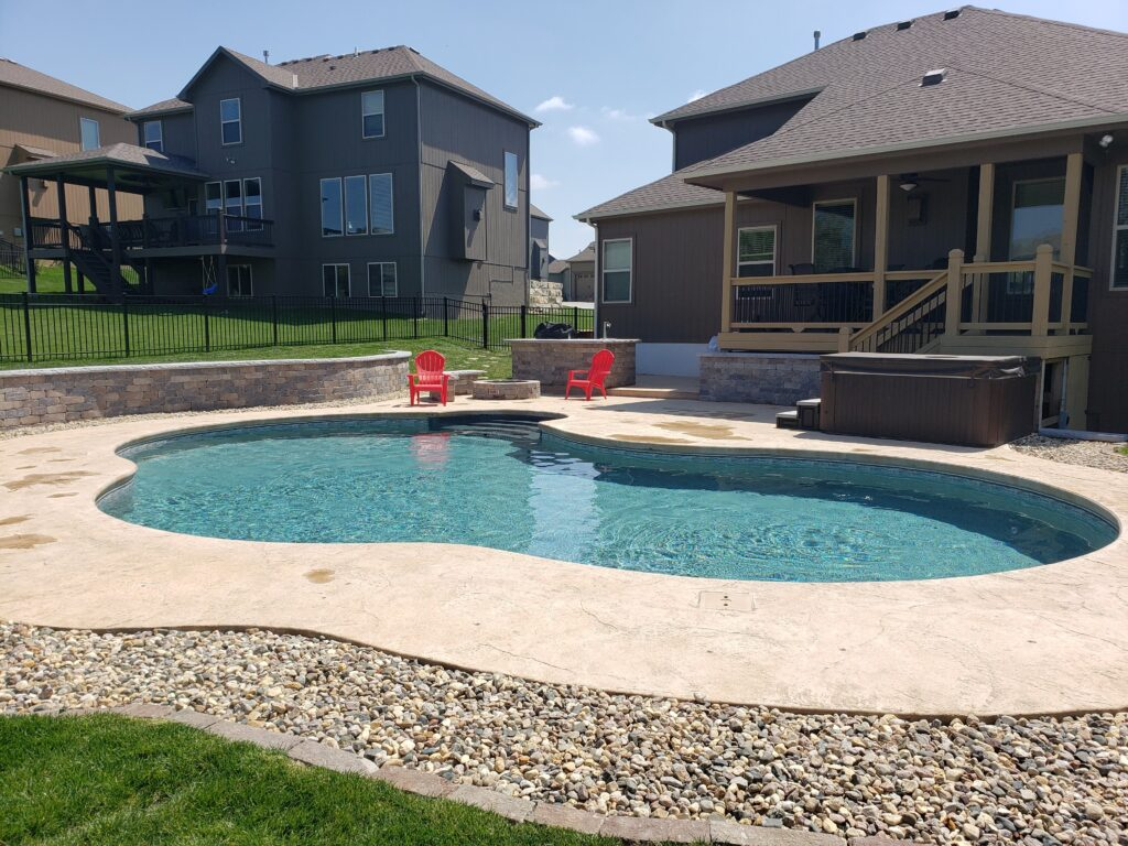 Custom Shaped Swimming Pool. Call us to book appointment 816-540-4400